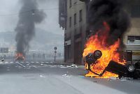 - manifestations against the international G8 summit in Genoa, July 2001, riots between police and demonstrators, set afire cars  ....- manifestazioni contro il summit internazionale G8 a Genova nel luglio 2001, scontri fra polizia e dimostranti, auto incendiate