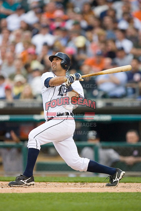 Gerald Laird #8 of the Detroit Tigers follows through on his swing versus the \New York Yankees at Comerica Park April 27, 2009 in Detroit, Michigan.  Photo by Brian Westerholt / Four Seam Images