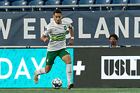 FOXBOROUGH, MA - AUGUST 26: Carlos Gomez #10 of Greenville Triumph SC dribbles during a game between Greenville Triumph SC and New England Revolution II at Gillette Stadium on August 26, 2020 in Foxborough, Massachusetts.
