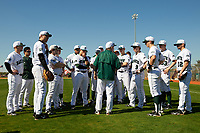 Dartmouth Big Green head coach Bob Whalen (jacket) talks with his team before a game against the Iowa Hawkeyes on February 27, 2016 at South Charlotte Regional Park in Punta Gorda, Florida.  Iowa defeated Dartmouth 4-1.  (Mike Janes/Four Seam Images)
