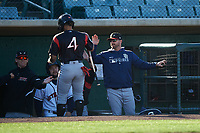 Lake Elsinore Storm hitting coach Doug Banks (8) congratulates Luis Campusano (4) after scoring a run during a California League game against the Lancaster JetHawks on April 10, 2019 at The Hanger in Lancaster, California. Lake Elsinore defeated Lancaster 10-0 in the first game of a doubleheader. (Zachary Lucy/Four Seam Images)