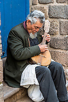 Peru, Cusco.  Blind Musician Playing for Donations.