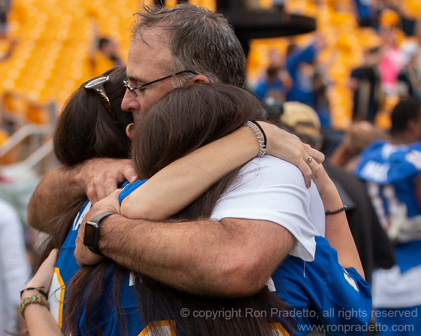 Pitt head coach Pat Narduzzi celebrates the win with his family. The Pitt Panthers defeated the Syracuse Orange 44-37 in overtime at Heinz Field in Pittsburgh, Pennsylvania on October 6, 2018.