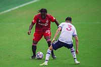 ORLANDO, FL - APRIL 24: Ayo Akinola #20 of Toronto FC dribbles the ball during a game between Vancouver Whitecaps and Toronto FC at Exploria Stadium on April 24, 2021 in Orlando, Florida.