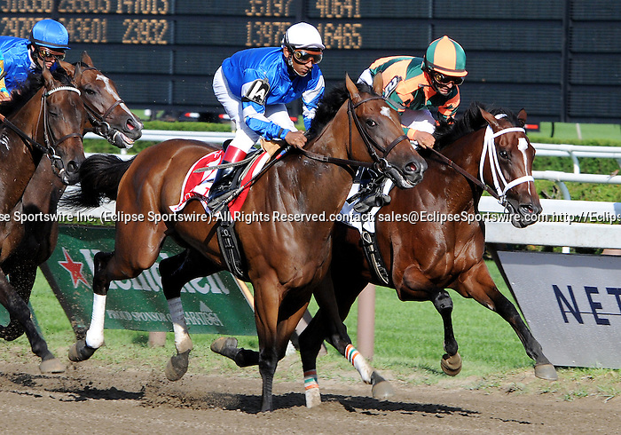 16 August 2008: Jockey Gabriel Saez gets Proud Spell (2) to settle into second position in Alabama Stakes at Saratoga Race Course in Saratoga Springs, New York.  Little Belle (1A) held the lead for most of the race until relinquishing it to winner Proud Spell.