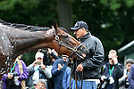 June 5, 2015: Raul Ramirez holds American Pharoah for a bath after his morning gallop in preparation for the Belmont Stakes at Belmont Park, Elmont, NY. Joan Fairman Kanes/ESW/CSM