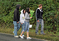 Pictured: Local youngsters leave flowers and tributes near the area where 15 year old Rebecca Aylward was found murdered in Aberkenfig south Wales. Tuesday 26 October 2010<br /> Re: South Wales Police are investigating the murder of fifteen year old Rebecca Aylward from Maesteg, whose body was discovered in woods in Aberkenfig near Bridgend south Wales. Two fifteen year old men have been arrested and are being questioned by police.