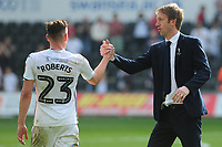 Connor Roberts celebrates at full time with Graham Potter Manager of Swansea City during the Sky Bet Championship match between Swansea City and Rotherham United at the Liberty Stadium in Swansea, Wales, UK.  Friday 19 April 2019