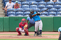 Tampa Tarpons Juan De Leon (27) bats in front of catcher Juan Aparicio (44) and umpire Rainiero Valero during a game against the Clearwater Threshers on June 13, 2021 at BayCare Ballpark in Clearwater, Florida.  (Mike Janes/Four Seam Images)