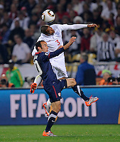 Landon Donovan (10) of USA goes up for the header against Ashley Cole (3) of England. USA vs England in the 2010 FIFA World Cup at Royal Bafokeng Stadium in Rustenburg, South Africa on June 12, 2010.