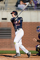 Kenny Swab #35 of the Virginia Cavaliers follows through on his swing versus the East Carolina Pirates at Clark-LeClair Stadium on February 20, 2010 in Greenville, North Carolina.   Photo by Brian Westerholt / Four Seam Images