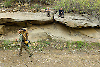 Photo story of Philmont Scout Ranch in Cimarron, New Mexico, taken during a Boy Scout Troop backpack trip in the summer of 2013. Photo is part of a comprehensive picture package which shows in-depth photography of a BSA Ventures crew on a trek.  In this photo a BSA Venture Crew Scouts make good use of a rock cliff inside of a rocky canyon area, during a trek climbing break in the backcountry at Philmont Scout Ranch.   <br /> <br /> The  Photo by travel photograph: PatrickschneiderPhoto.com