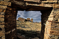 The Great House at Pueblo Pintado, a Chacoan outlier in the San Juan Basin of northwestern New Mexico, seen through a doorway in a nearby ruin.