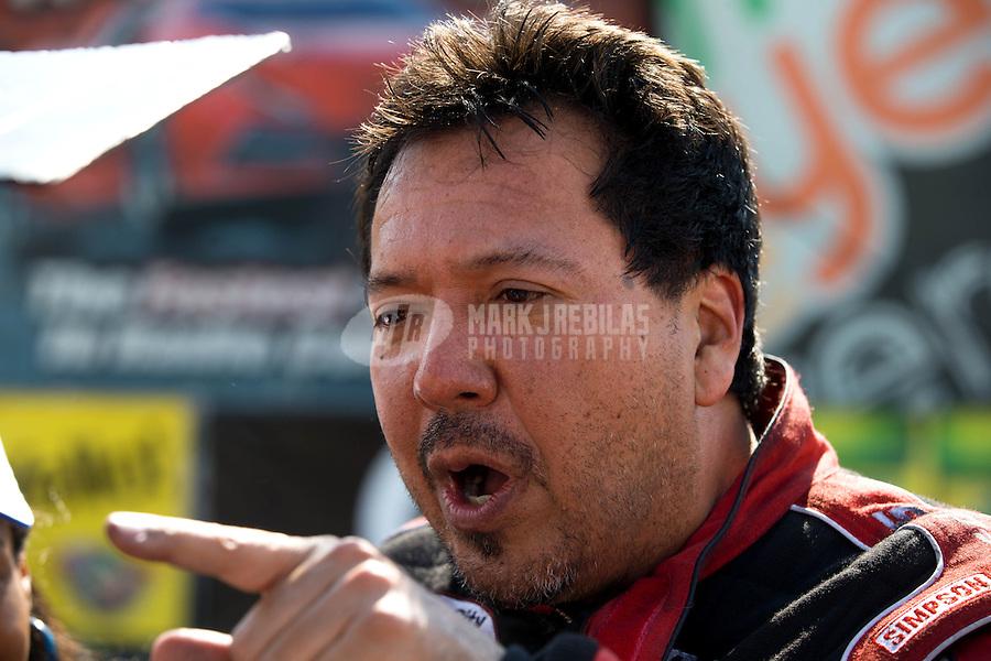 Jul. 21, 2013; Morrison, CO, USA: NHRA funny car driver Cruz Pedregon celebrates after winning the Mile High Nationals at Bandimere Speedway. Mandatory Credit: Mark J. Rebilas-