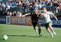 Rachel Buehler and Lori Chalupny, right, battle for the ball, St. Louis Athletica over FC Gold Pride 1-0 at Buck Shaw Stadium, in Santa Clara, California, Sunday, July 5, 2009.