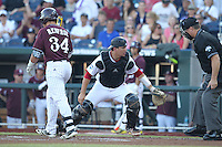 Mississippi State Bulldogs outfielder Hunter Renfroe #34 and Indiana Hoosiers catcher Kyle Schwarber #10 during Game 6 of the 2013 Men's College World Series between the Indiana Hoosiers and Mississippi State Bulldogs at TD Ameritrade Park on June 17, 2013 in Omaha, Nebraska. (Brace Hemmelgarn/Four Seam Images)