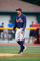 Danville Braves pitching coach Kanekoa Texeira (50) walks to the mound during a game against the Johnson City Cardinals on July 28, 2018 at TVA Credit Union Ballpark in Johnson City, Tennessee.  Danville defeated Johnson City 7-4.  (Mike Janes/Four Seam Images)