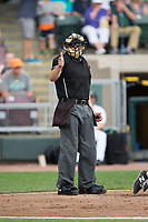 Home plate umpire Jason Johnson makes a strike call during the Midwest League game between the West Michigan Whitecaps and the Dayton Dragons at Fifth Third Field on May 29, 2017 in Dayton, Ohio.  The Dragons defeated the Whitecaps 4-2.  (Brian Westerholt/Four Seam Images)