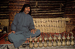 Marsh Arabs. Southern Iraq.  Marsh Arab man in communal village reed constructed building with coffee pots. Haur al Mamar or Haur al-Hamar marsh collectively known now as Hammar marshes Iraq 1984
