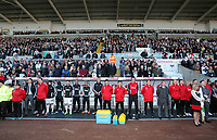Pictured: The Swansea bench observe a minute's silence  before kick off in memory of Wales football manager Gary Speed who has died. Saturday 27 November 2011<br /> Re: Premier League football Swansea City FC v Aston Villa at the Liberty Stadium, south Wales.