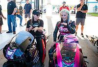 Oct 18, 2019; Ennis, TX, USA; NHRA pro stock motorcycle rider Angie Smith (right) with pro stock driver Erica Enders during qualifying for the Fall Nationals at the Texas Motorplex. Mandatory Credit: Mark J. Rebilas-USA TODAY Sports