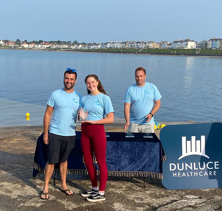 Jessika Robson first Female 5k, with left Ryan Smith of sponsors Dunluce Healthcare and Alan Whyte Club Captain