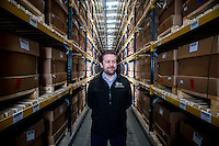 Tuesday 28 February 2017<br /> Pictured: Scott Kuperus, The Royal Mint's technical manager Stands in front of hundreds of boxes of one pound coins that are being stored ahead of distribution Re: The Royal Mint in Llantrisant is producing the new one pound coin