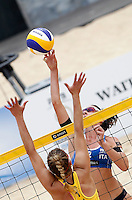 Italy's Greta Cicolari, right, in action against April Ross, of the United States, at the Beach Volleyball World Tour Grand Slam, Foro Italico, Rome, 22 June 2013. United States defeated Italy 2-0.<br /> UPDATE IMAGES PRESS/Isabella Bonotto