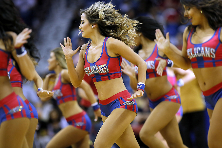 NEW ORLEANS, LA - MARCH 26: A cheerleader for the New Orleans Pelicans performs during a game during a game at the Smoothie King Center on March 26, 2016 in New Orleans, Louisiana. NOTE TO USER: User expressly acknowledges and agrees that, by downloading and or using this photograph, User is consenting to the terms and conditions of the Getty Images License Agreement.  (Photo by Jonathan Bachman/Getty Images)