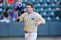 Matt Smith (17) of the Western Carolina Catamounts scores the team's ninth run in the bottom of the ninth inning of a SoCon Tournament game against Wofford College on Wednesday, May 25, 2016, at Fluor Field at the West End in Greenville, South Carolina. Western won, 10-9. (Tom Priddy/Four Seam Images)