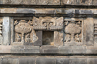 Yogyakarta, Java, Indonesia.  Prambanan Temples.  Carving near Base of Nandi Temple, showing Kinara and Kinari (Mythical Birds with Human Heads) Guarding Kalpataru, the Tree of Heaven.  A Lion is missing from the central niche. (See _JAV9912)