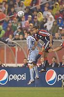 New England Revolution defender Kevin Alston (30) and Colorado Rapids midfielder Colin Clark (23) battle for head ball. The New England Revolution tied the Colorado Rapids, 1-1, at Gillette Stadium on May 16, 2009.