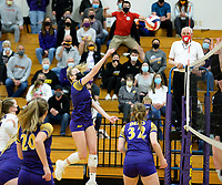 DeForest's Natalie Compe hits over the net, as DeForest tops Waunakee 3 sets to 1 in Wisconsin WIAA girls high school volleyball regional finals on Saturday, Apr. 10, 2021 at DeForest High School