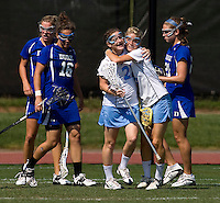 Emily Garrity (22) and Kristen Taylor (5) of North Carolina celebrate a goal during the ACC women's lacrosse tournament semifinals in College Park, MD.  North Carolina defeated Duke, 14-4.