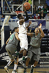 Hug's Norris Dupree passes over Green Valley's Clyde Austin during a semi-final game in the NIAA 4A State Basketball Championships between Hug and Green Valley high schools at Lawlor Events Center in Reno, Nev, on Thursday, Feb. 23, 2012. Hug won 70-68..Photo by Cathleen Allison
