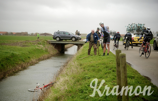 Gert Steegmans (BEL/Trek Factory Racing) was simply blown into a ditch 2 meters down, off the road by the fierce winds (up to 80km/h) in the infamous Moeren, as other passing riders lean into the wind to be able to stay on the bike. <br /> His bike went under and the team mechanic had to go fish it out. Steegmans abandoned at the spot with an injury to  the face. <br /> <br /> 77th Gent-Wevelgem 2015