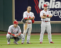 Phillies outfielders Greg Dobbs, Shane Victorino, and Geoff Jenkins wait on a pitching change on Thursday May 22nd at Minute Maid Park in Houston, Texas. Photo by Andrew Woolley / Four Seam Images.