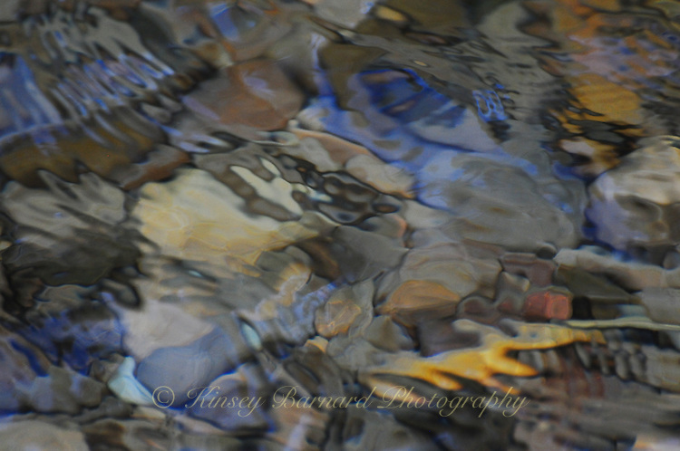 """""""RIVER MOSAIC""""<br /> <br /> Soft, colorful abstract images of stones and pebbles beneath the cool waters of the Tobacco River in Montana. ORIGINAL 24 X 36 GALLERY WRAPPED CANVAS SIGNED BY THE ARTIST $2,500. CONTACT FOR AVAILABILITY."""
