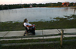 Bob Harkey, 71, rolls past a flooded Burrus Field in Buxton, NC, after Hurricane Irene passed through on Sunday, Aug. 28, 2011. Photo by Ted Richardson