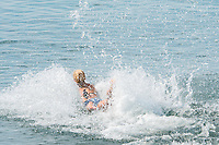 Aberystwyth Wales UK, Thursday 12 May 2016<br /> UK Weather: A young woman dives into the sea at the seaside in Aberystwyth, on the Cardigan Bay coast of west Wales, enjoying a last day of warm weather in the current mini-heatwave. <br /> The temperatures are set to fall over the coming days, with bright but colder conditions prevailing over the country