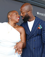 LOS ANGELES - AUG 8:  Aisha Hinds,  fiance Silky Valente at the Heirs Of Afrika 4th Annual International Women of Power Awards at the Marriott Marina Del Rey on August 8, 2021 in Marina Del Rey, CA