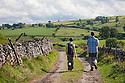 Walkers above Monsal Dale near Brushfield, Peak District National PArk, Derbyshire, UK. August. Model Released.