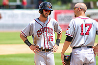 Quad Cities River Bandits second baseman David Hensley (15) talks with manager Mickey Storey (17) during a pitching change in a Midwest League game against the Kane County Cougars on July 1, 2018 at Northwestern Medicine Field in Geneva, Illinois. Quad Cities defeated Kane County 3-2. (Brad Krause/Four Seam Images)