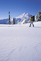 Man snowshoeing in mountains, Washington Cascade Mountains