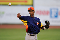 Shortstop Jeffry Santos (21) of the Greeneville Astros warms up before a game against the Bristol Pirates on Saturday, July 26, 2014, at DeVault Memorial Stadium in Bristol, Virginia. Greeneville won, 4-0 in Game 2 of a doubleheader. (Tom Priddy/Four Seam Images)