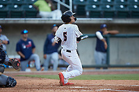 Laz Rivera (5) of the Birmingham Barons follows through on his swing against the Pensacola Blue Wahoos at Regions Field on July 7, 2019 in Birmingham, Alabama. The Barons defeated the Blue Wahoos 6-5 in 10 innings. (Brian Westerholt/Four Seam Images)