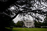 The White House stands past the South Lawn in Washington, D.C., U.S., on Friday, May 22, 2020. United States President Donald J. Trump didn't wear a face mask during most of his tour of Ford Motor Co.'s ventilator facility Thursday, defying the automaker's policies and seeking to portray an image of normalcy even as American coronavirus deaths approach 100,000. <br /> Credit: Andrew Harrer / Pool via CNP/AdMedia
