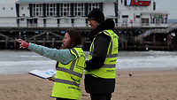 BNPS.co.uk (01202 558833)<br /> Pic: EllipsisEarth/BNPS<br /> <br /> Pictured: Ellipsis Earth scientists undertaking litter mapping on the beach in Bournemouth.<br /> <br /> Litter dropped in Britain's most popular seaside resort reduced by 75 per cent this summer thanks to a new project using drone technology. <br /> <br /> The first-of-its kind survey identified alarming litter patterns along Bournemouth beach in Dorset with a staggering 123,000 bits of litter discarded in just one week.<br /> <br /> The data was then used to target the worst areas with strategic bin placement.