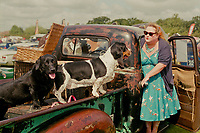 Women with dogs at a car boot sale, Wiggenhall St Germans, Norfolk,UK.