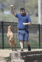 Riley Holliday of Springdale plays with his dog Ryu, Thursday, April 1, 2021 at the Bentonville Dog Park in Bentonville. Check out nwaonline.com/210402Daily/ for today's photo gallery. <br />